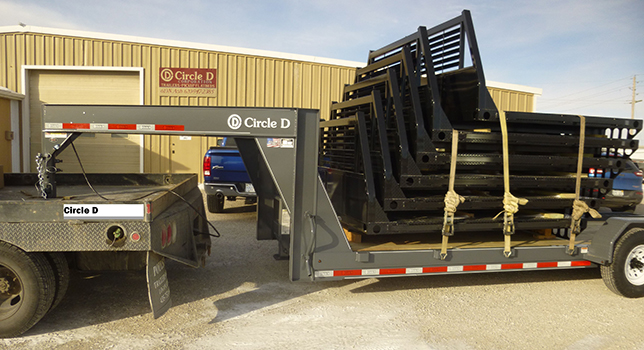 A new load of Circle D flatbeds and a new gooseneck low profile equipment trailer just arrived